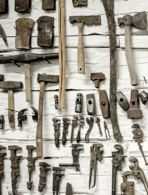 Collection of tools hanging on a wall